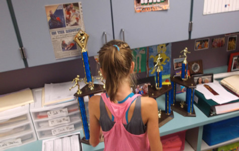 "TROPHIES IN HER FUTURE. Cross Country runner Julianna is one of the rising stars in middle school sports. Julianna was an important reason why Sevier Middle School won the Kingsport city championship. ""Julianna is only a 7th grader. I look forward to coaching her next year as an 8th grader,"" John Sevier Middle School cross country coach Julie Potts said."