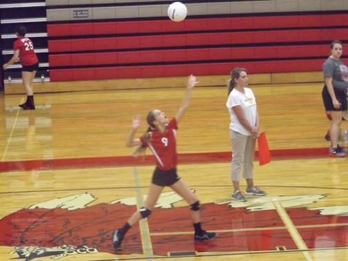 GETTING READY TO SERVE. Sibley Carter gets ready to serve the ball to start the play.