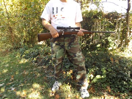 RIGHT TO BEAR ARMS. A resident of Kingsport poses with one of his rifles. The right to bear arms has become a major controversy. Many people believe gun ownership is an essential freedom, while others feel that there should be more restrictions on who can own guns.