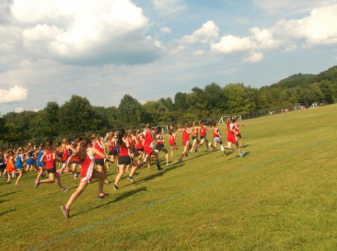 AND THEY'RE OFF.  The girls start their race as they sprint across the warrior's park soccer field