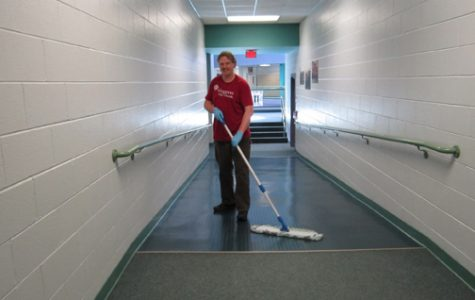 Team of custodians prepare the building for a new year