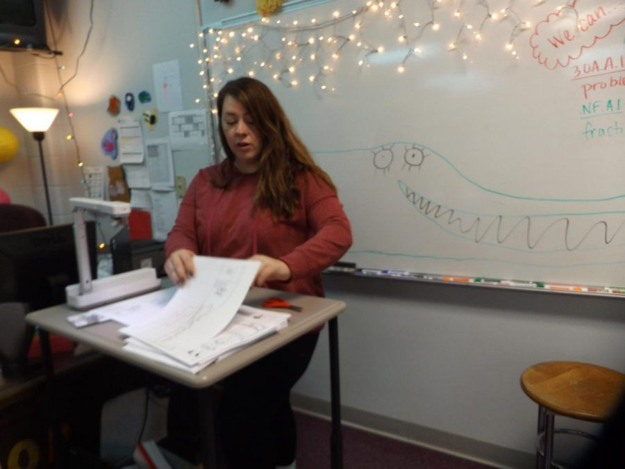 Megan Roop works with students on function academics