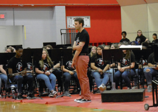 VOLUNTEER BUILDER. Hunter Mullins, center, directs the Sevier Band during a spring concert. He recently volunteered to help build a new playground at Johnson.