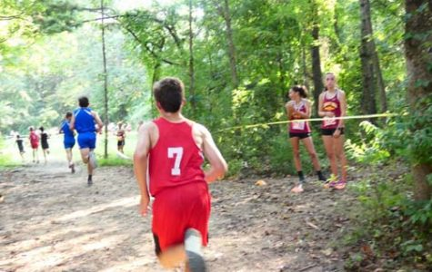 RUNNING PAST THE COMPETITION. Sam Perdue, center, participates in the
