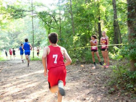"RUNNING PAST THE COMPETITION. Sam Perdue, center, participates in the ""Warrior Invitational"" cross country meet. Perdue made huge gains as a runner since sixth grade, when he first joined the team."