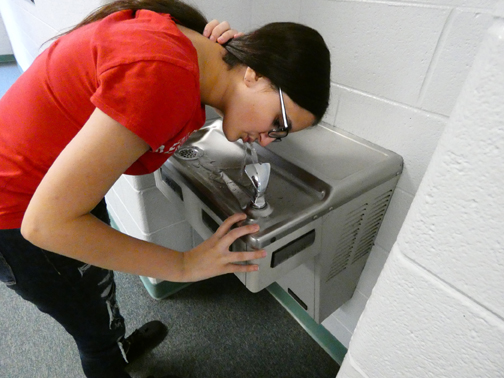 A CLEAN DRINK OF WATER. Rayna Welsch drinks from a fountain at Sevier Middle. KCS recently replaced several fountains across the district due to lead.