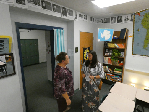 DISCUSSING GRADES. Social Studies teacher Rebekah Tipton meets with a parent during open house. Grades are one way teachers report student progress to the parents.