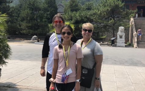ON CHINESE SOIL. Emma Baker, center, a student at Robinson Middle School, traveled with her parents to China to learn about her heritage this past summer.