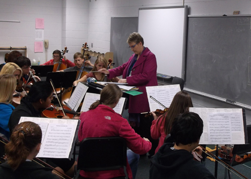 A PASSION FOR TEACHING. Guice teaches her orchestra students at Sevier Middle in this 2013 file photo. She spent more than 25 years teaching passing along her passion for music to students of all ages.