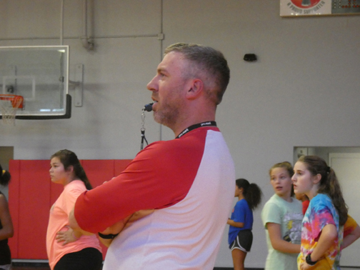 BUILDING A STRONGER TEAM. Stephen Williams, center , oversees girls basketball team tryouts. Williams took over coaching the varsity team this school year.