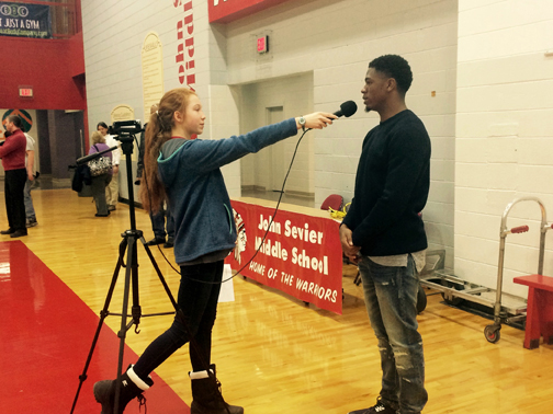 YOUNG JOURNALIST. During her time in middle school, Kristin Thorneloe, left, interviewed Coty Sensabaugh, former Sevier student and player for the NFL Washington Redskins.