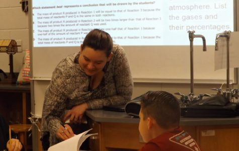 SCIENTIFIC MUSICK. Katrina Musick, left, helps one of her students grasp a new scientific concept. Musick joined Sevier's staff as a new teacher this school year.