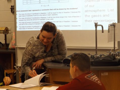 SCIENTIFIC MUSICK. Katrina Musick, left, helps one of her students grasp a new scientific concept. Musick joined Sevier