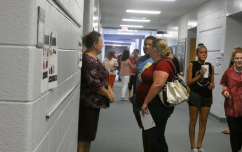 UNDER SURVEILLANCE. Teacher Rebekah Tipton, left, speaks with parents during Sevier's Open House. Security cameras monitor everything in the hallways at Sevier.