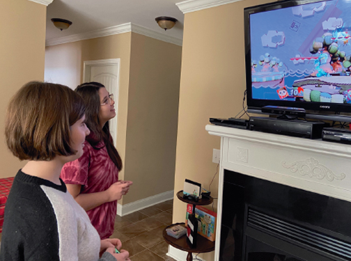 TIME TO PLAY THE GAME. Two members of Robinson Middle School's eSports team play Super Smash Bros. on Nintendo Switch.